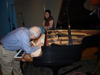Piano technician David Lamoreaux  during a daily touch-up