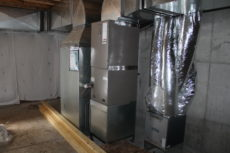 HVAC components in basement. L to R: Custom duct silencer, Furnace, ERV